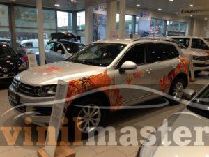 Оклейка автомобилей к Олимпийским играм в Сочи Volksvagen Tiguan передний левый угол
