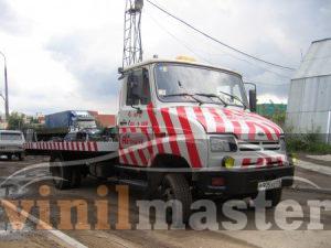 Оклейка пленкой эвакуаторов для компании А 24 ЗИЛ правая боковина